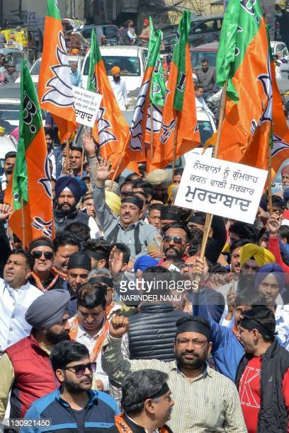 Bharatiya Janata Party leaders and workers shout slogans during a protest march against the Congress Party local government in Amritsar on March 16...