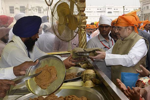 Bharatiya Janata Party National President Amit Shah paying obeisance at Golden Temple on November 1 2016 in Amritsar India