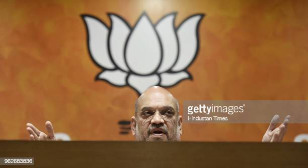 Bharatiya Janata Party President Amit Shah addresses a press conference on four years of NDAs Government at BJP Headquarters on May 26 2018 in New...