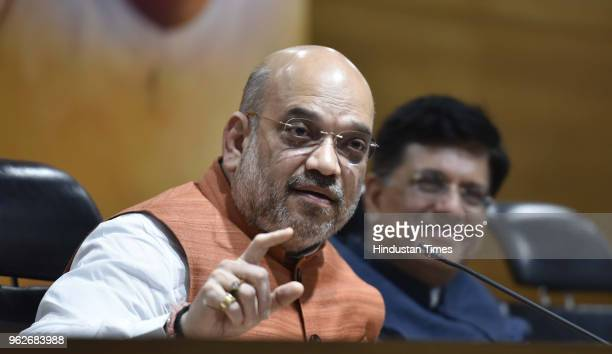 Bharatiya Janata Party President Amit Shah with Railways and coal minister Piyush Goyal address a press conference on four years of NDAs Government...