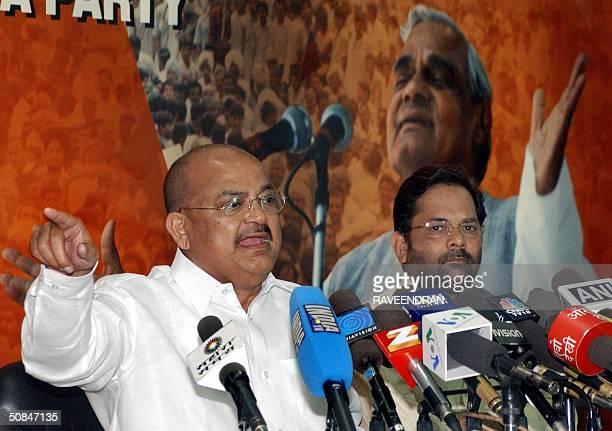 Bharatiya Janata Party President Venkaiah Naidu addresses a press conference at the BJP headquaters in New Delhi 17 May 2004 while BJP general...