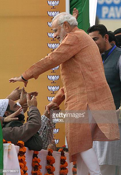 Bharatiya Janata Party Prime Ministerial candidate and Chief Minister of the western Indian state of Gujarat Narendra Modi greets supporters during...