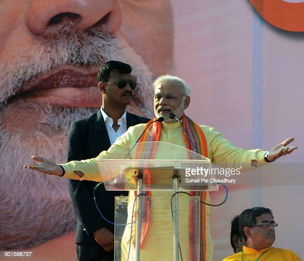 Bharatiya Janata Party prime ministerial candidate and India's Gujarat state Chief Minister Narendra Modi deliver the speech during a mass rally in...