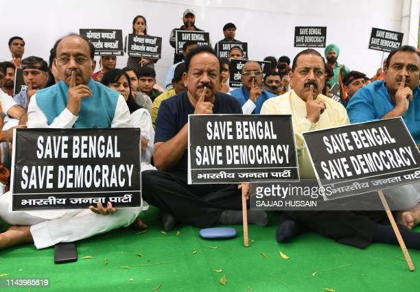 Bharatiya Janata Party senior leaders Vijay Goel, Harsh Vardhan, and Jitendra Singh, along with party supporters hold placards during a silent...