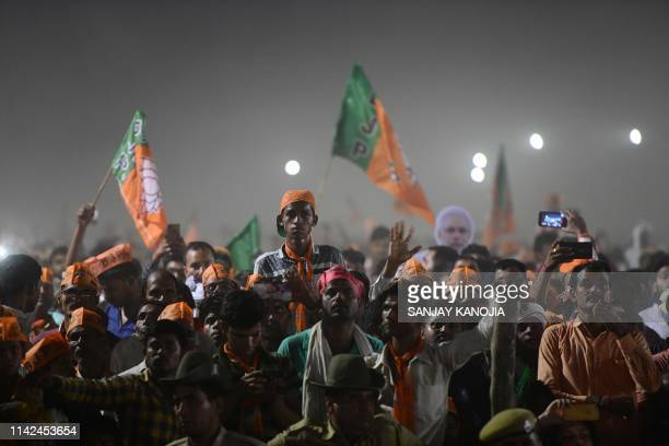 TOPSHOT Bharatiya Janata Party supporters attend a rally as Indian Prime Minister Narendra Modi delivers a speech during a rally ahead of Phase VI of...