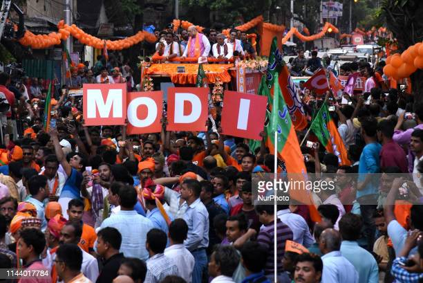 Bharatiya Janata Party supporters attend National President Amit Shah at the Election Camping Road Show in Kolkata City on May 142019 in India