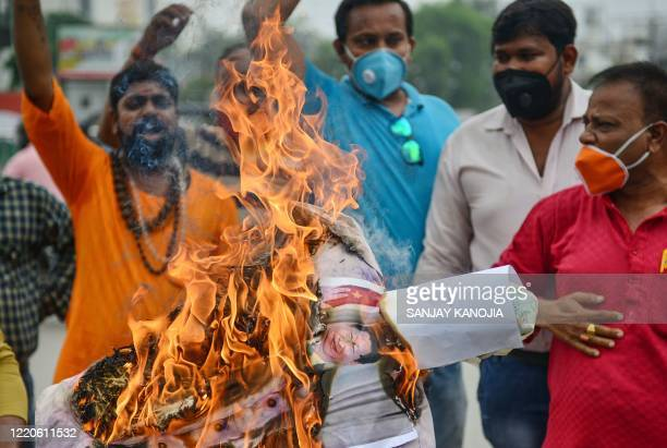 Bharatiya Janata Party supporters burn posters and effigy of Chinese President Xi Jinping during an antiChina protest in Allahabad on June 17 2020...