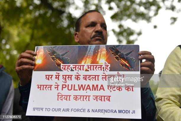 Bharatiya Janata Party supporters celebrate reports of IAF air strikes across LoC at Jantar Mantar on February 26 2019 in New Delhi India Indian...