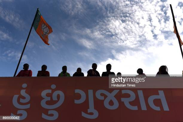Bharatiya Janata Party supporters gather at party office winning Gujarat Assembly Elections 2017 on December 18 2017 in Ahmedabad India The saffron...