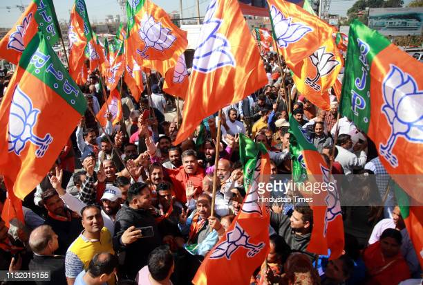 Bharatiya Janata Party supporters seen along with Union Minister and BJP Candidate Jugal Kishore Sharma as he arrives to file his nomination for...