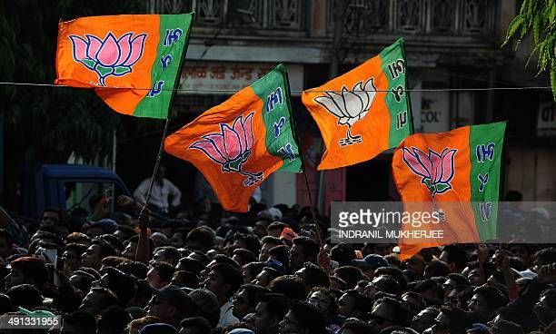 Bharatiya Janata Party supporters wave flags during a public rally by BJP prime ministerial candidate Narendra Modi after his victory in Vadodara on...
