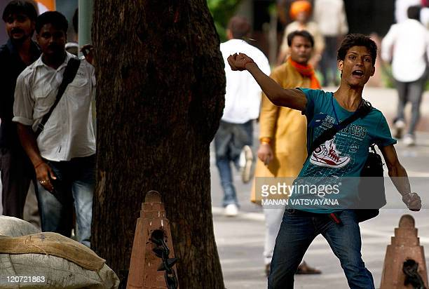 A Bharatiya Janata Party Youth activist throws stones during a protest in New Delhi on August 9 2011 An antigovernment protest by the opposition BJP...