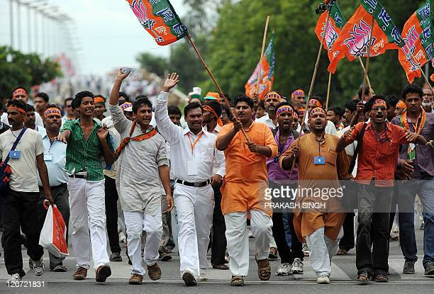 Bharatiya Janata Party Youth Wing activists shout antigovernment slogans as they march during a BJP Youth Wing rally against alleged corruption by...