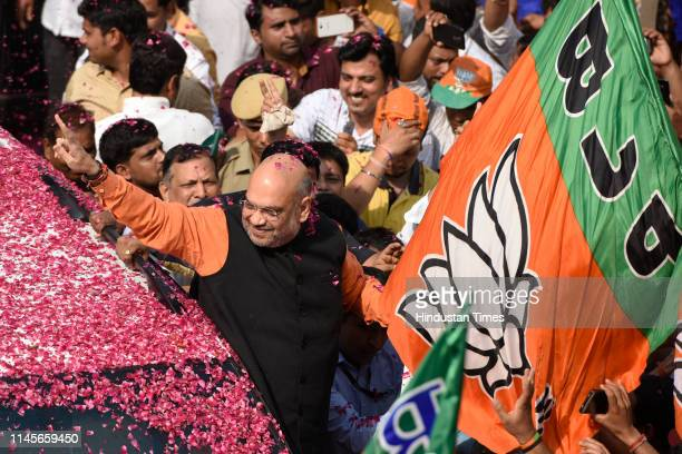 Bharatiya Janta Party president Amit Shah shows a victory sign as he arrives at the party headquarters on May 23 2019 in New Delhi India Riding on a...