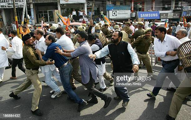 Bharatiya Janta Party workers scuffle with policemen during a protest against the price hike on the first day of the reopening of civil secretariat...