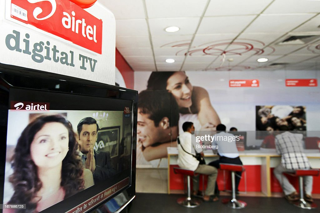 A Bharti Airtel Ltd. digital TV stands on display at the company's flagship store in Mumbai, India on Thursday, May 2, 2013. Bharti Airtel, India's largest mobile-phone operator, posted profit that missed analyst estimates after a weaker rupee raised the interest payments and prices for network equipment. Photographer: Kuni Takahashi/Bloomberg via Getty Images
