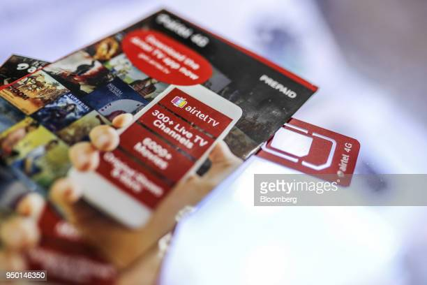 A Bharti Airtel Ltd sim card and sim card packs are arranged for a photograph at a store in Mumbai India on Saturday April 21 2018 Bharti Airtel are...