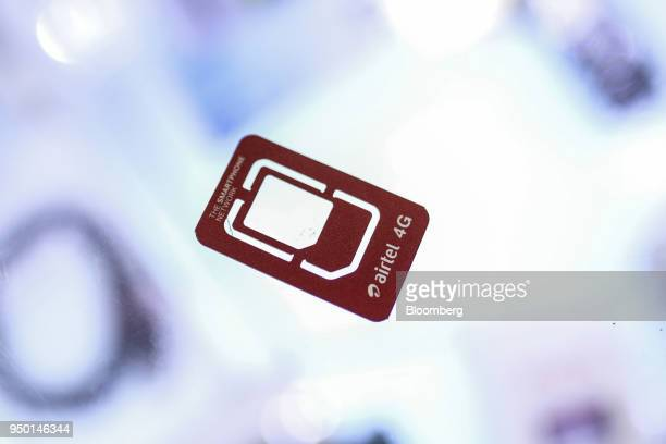A Bharti Airtel Ltd sim card holder is arranged for a photograph at a store in Mumbai India on Saturday April 21 2018 Bharti Airtel are scheduled to...