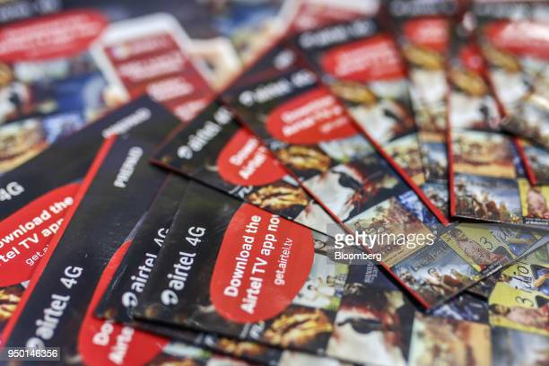 Bharti Airtel Ltd sim card packs are arranged for a photograph at store in Mumbai India on Saturday April 21 2018 Bharti Airtel are scheduled to...