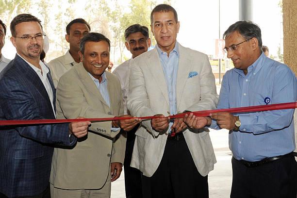 Bharti Enterprises Vice Chairman and Managing Director Rajan Bharti Mittal and Bharti WalMart Managing Director and CEO Raj Jain cut the ribbon to...