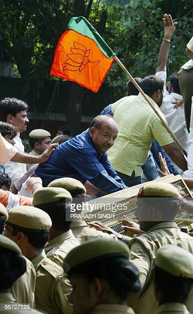 Bhartiya Janata Party Delhi President Harshvardhan climbs on a police barricade during a protest against the Congress party on KGB revelation in New...