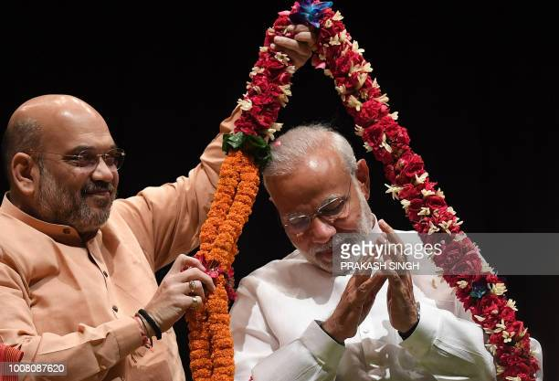 Bhartiya Janata Party President Amit Shah garlands Indian Prime Minister Narendra Modi on winning the Noconfidence motion moved by opposition last...
