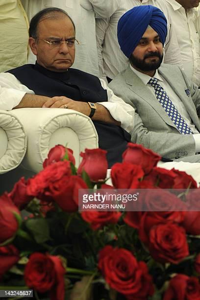 Bhartiya Janata Party senior leader Arun Jaitley and former cricketer and Bharatiya Janata Party member of parliament Navjot Singh Sidhu sit during a...