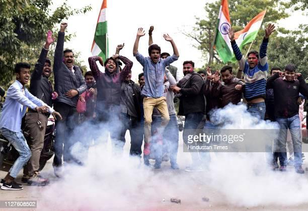 Bhartiya Janata Party Yuva Morcha celebrating after Indians airstrike on the JaisheMohammeds biggest camp in Pakistans Balakot town in Noida India on...