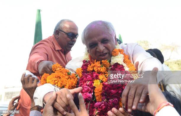 Bhartiya Janta Party candidate Bhupendrabhai Patel celebrates after winning the Gujarat Vidhan Sabha election in Ahmedabad on December 18 2017 Indian...