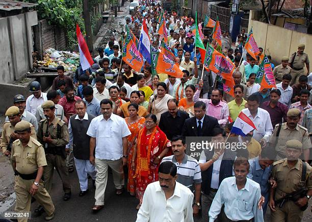 Bhartiya Janta Party candidate for the Guwahati Lok Sabha constituency Bijoya Chakravarty is accompanied by supporters as she goes to submit her...