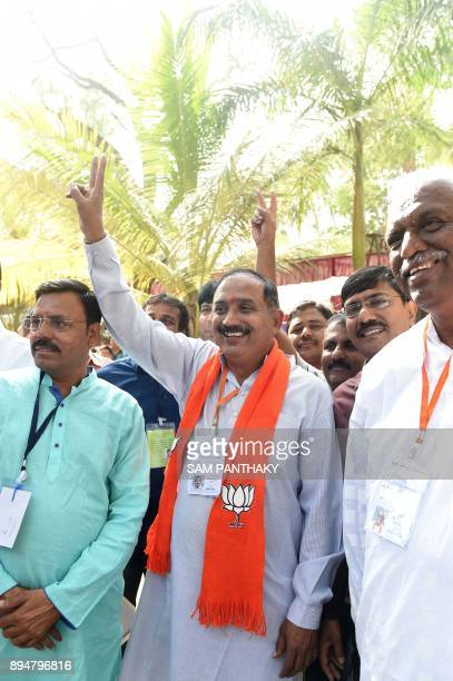 Bhartiya Janta Party candidate from the Paldi constituency Rakeshbhai Shah celebrates after winning the Gujarat Vidhan Sabha election in Ahmedabad on...
