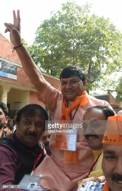 Bhartiya Janta Party candidate from the Sabarmati constituency Arvindbhai Patel celebrates after winning the Gujarat Vidhan Sabha election in...