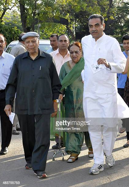Bhartiya Janta Party Chandigarh President Sanjay Tandon arrives with his father Balramji Das Tandon and other family members to cast their votes at...