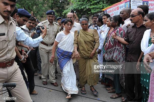 Bhartiya Janta Party MLA and former minister in the Narendra Modi state government Maya Kodnani is escorted by police on her arrival at special court...