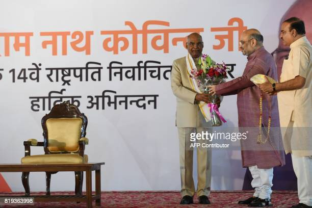 Bhartiya Janta Party President Amit Shah greets India's President elect Ram Nath Kovind during a ceremony after his election in New Delhi on July 20...