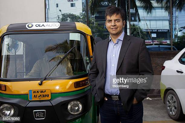 Bhavish Aggarwal chief executive officer and cofounder of ANI Technologies Pvt owners of ridehailing service Ola stands for a photograph in Bengaluru...