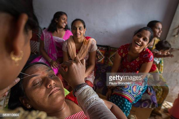 Bhavna Headod is a home based worker who has a beauty parlor Bhavna works on a customers eyebrows at the salonShe took a micro loan for the parlor...