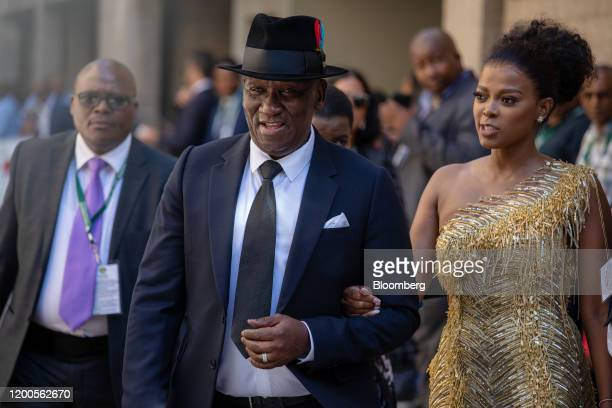 Bheki Cele South Africa's police minister and his wife Thembeka Ngcobo arrive during the state of the nation ceremony in the national assembly in...