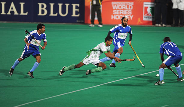 Bhopal Badshahs hockey player Yousuf Affan in action with Chandigarh Comets hockey players during the first match of World Series Hockey tournament...