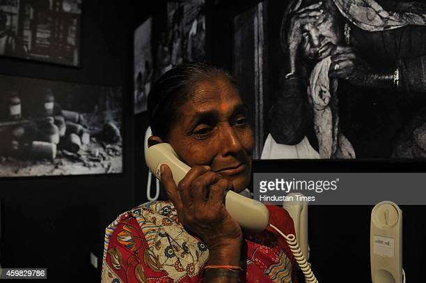 Bhopal gas tragedy survivor woman get emotional during her visit to the museum 'Remember Bhopal' that is dedicated to memories of the tragedy during...