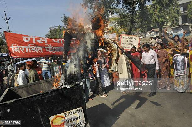 Bhopal Gas tragedy victims burning the effigy of DOW chemicals on the eve of 30th anniversary of Bhopal Gas tragedy on December 2 2014 in Bhopal...