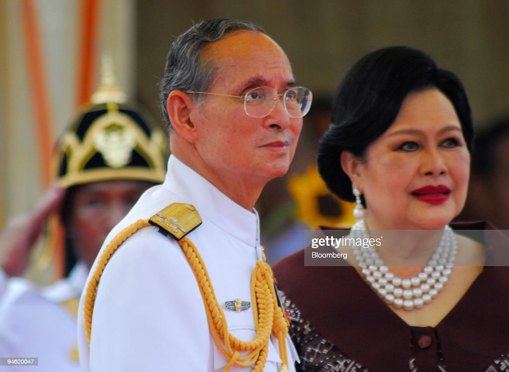 Bhumibol Adulyadej, king of Thailand, and his wife Sirikit watch the inauguration of a Royal Thai Navy costal patrol boat at the Navy boatyard in Bangkok, Thailand, on Monday, April 30, 2007. Thailand's prime minister pauses briefly and swallows hard as he addresses the question few of his compatriots dare contemplate: life without King Bhumibol Adulyadej, the world's longest-reigning monarch. 'I am under no illusion -- it will be a very difficult time for all of us,' says Abhisit Vejjajiva, who in December patched together a multiparty coalition government and became troubled Thailand?s fifth prime minister in four years.