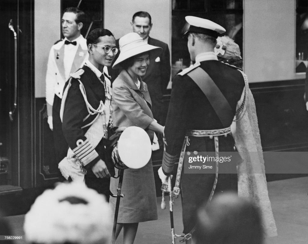 Bhumibol Adulyadej (1927 - 2016, left), King of Thailand, and Queen Sirikit are greeted by Queen Elizabeth and Prince Philip at Victoria Station, London, at the start of a three-day state visit to Britain, 19th July 1960. The Thai Royal couple have just arrived from Gatwick Airport.