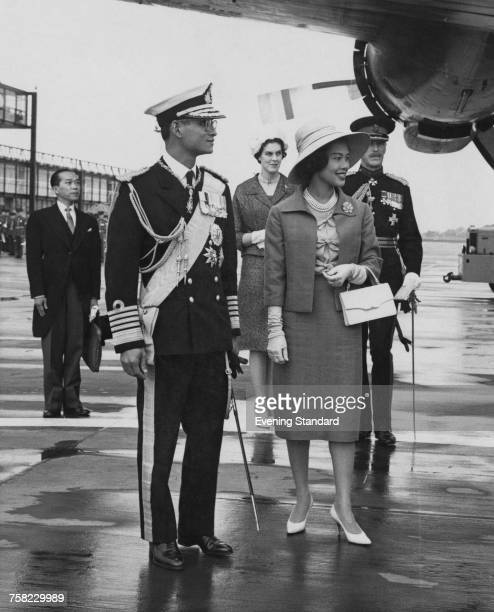 Bhumibol Adulyadej King of Thailand and Queen Sirikit at Gatwick Airport at the start of a threeday state visit to Britain 19th July 1960