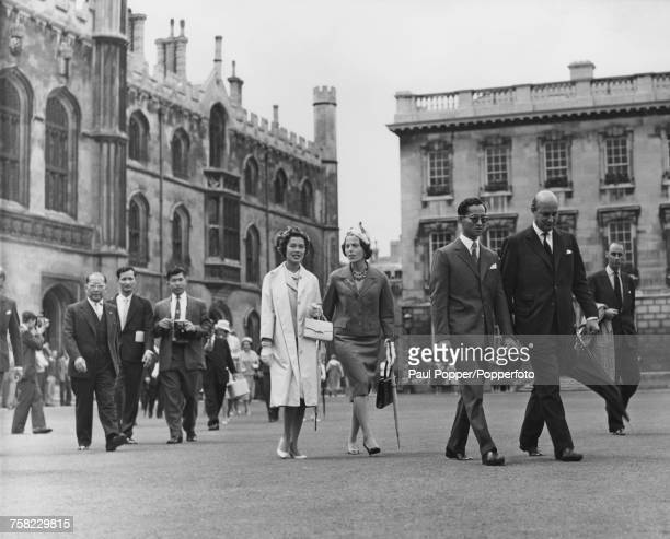 Bhumibol Adulyadej King of Thailand and Queen Sirikit on a tour of Cambridge University during a threeday state visit to Britain Cambridge 21st July...