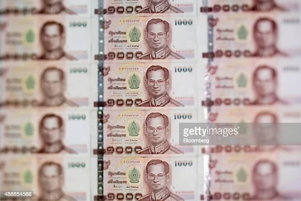 Bhumibol Adulyadej king of Thailand is displayed on Thai 1000 baht banknotes in an arranged photograph in Bangkok Thailand on Thursday Sept 17 2015...