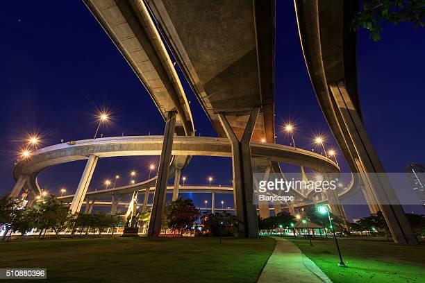 Bhumibol Bridge above park at dawn in Bangkok, Thailand
