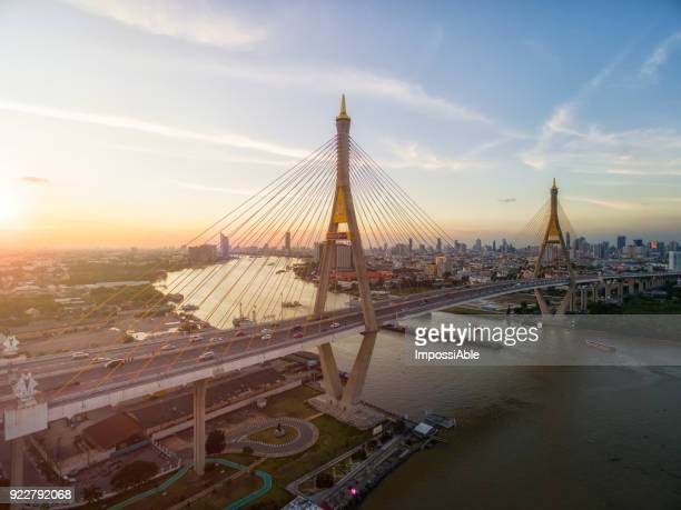 bhumibol suspension bridge cross the chaophraya river at sunset, bangkok, thailand - association of southeast asian nations stock photos and pictures