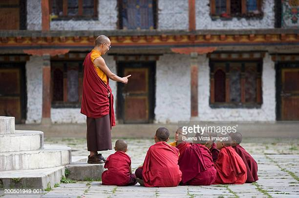 bhutan, bumthang, karchu dratsang monastery, buddhist lama teaching - religious occupation stock pictures, royalty-free photos & images