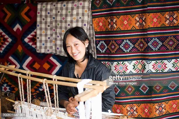 Bhutan, Bumthang, woman weaving, smiling, portrait
